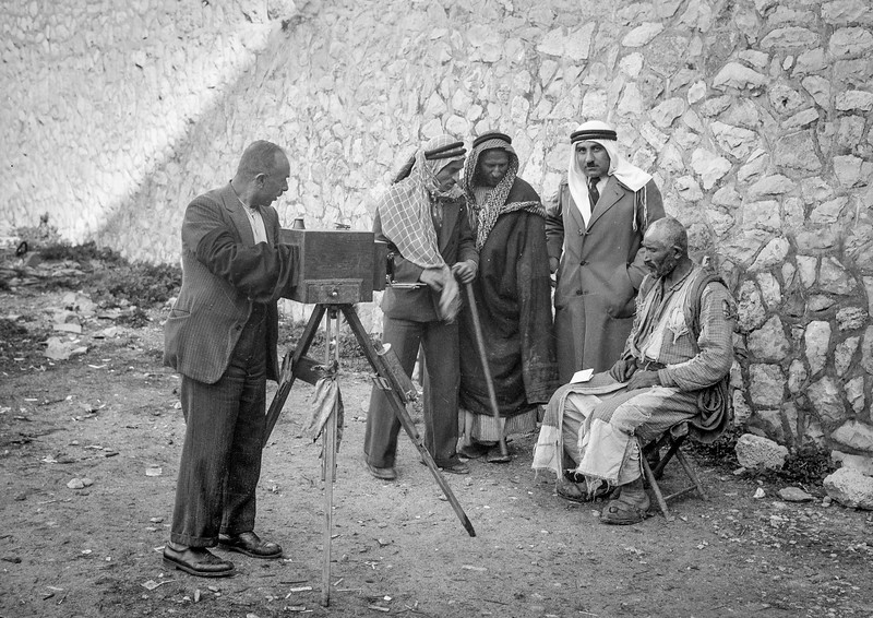 Palestinian being photographed for identity card with headdress removed. 1934-1939