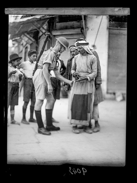 129.  Palestine resistance. Searching citizens for arms at the Jaffa Gate. 1936