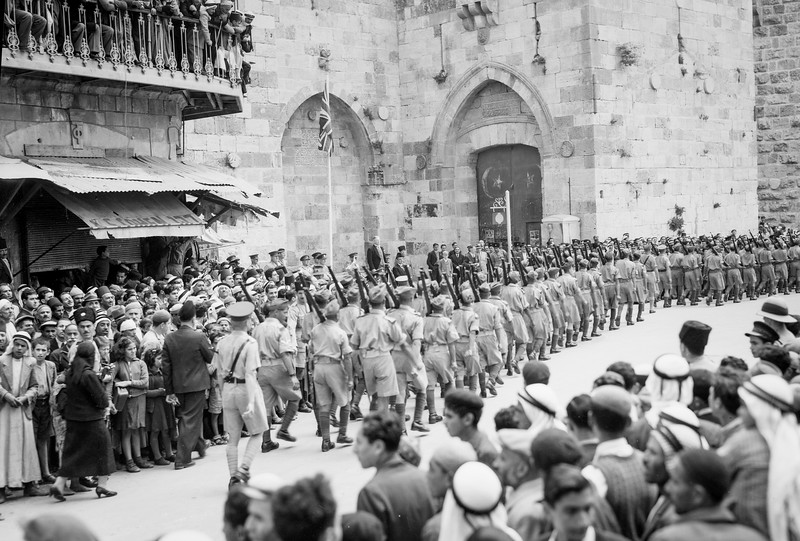 Arab recruits on parade passing Jaffa Gate in Jerusalem. 1941