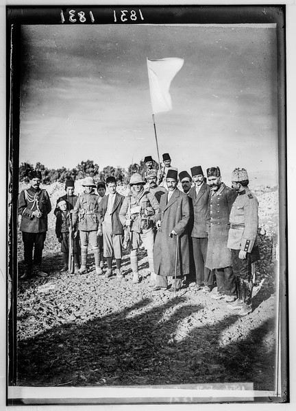 The surrender of Jerusalem to the British, December 9, 1917. The Mayor of Jerusalem, with white flag, offers surrender to two British tommies (sergeants).  1917
