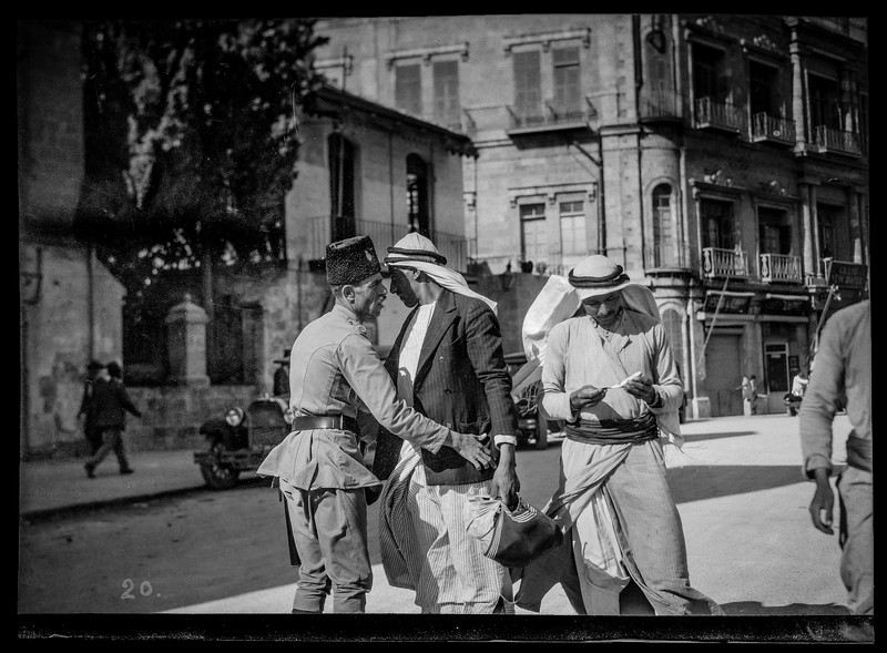 Arab resident searched for arms at Jaffa Gate following uprisings. August 1929