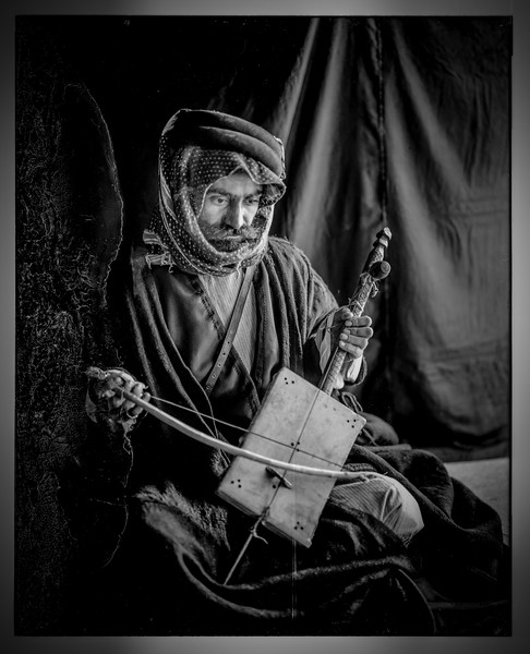 Bedouin man playing the rababeh. 1898-1946