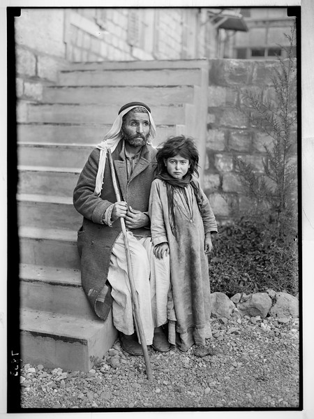 Scots Mission Hospital, Tiberias. Blind man being led by daughter seeking help at hospital and daughter waiting outside clinic.  1934-1939