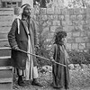 Scots Mission Hospital, Tiberias.  Blind man being led by daughter seeking help at hospital.  1934-1939