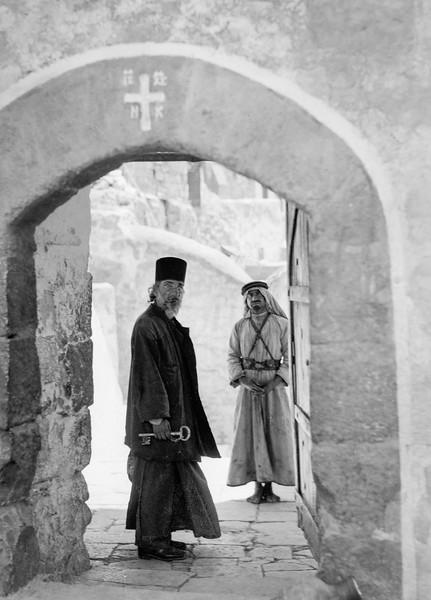 197.  Doorway with monk looking in at Mar Saba, Greek Orthodox monastery. 1934–1939
