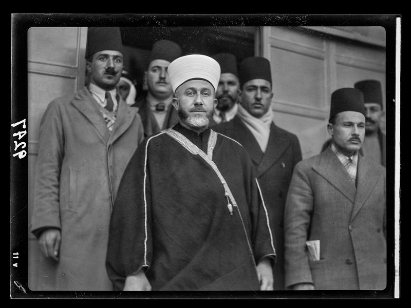 199.  Palestine resistence. The Grand Mufti, Haj Amin al-Husseini, with attendants, leaving the offices of the Palestine Royal Commission after giving his evidence. 1937