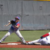 Floyd's Edgardo Chavez, number 4, slides safely into third base past McCurdy's Matthew Martinez, number 00, during the bottom of the second inning of the semifinal Class 1A-2A State Tournament baseball game between McCurdy High School vs Floyd High School at Cleveland High School on Thursday, May 12, 2016. Luis Sánchez Saturno/The New Mexican