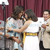 Fatima Garcia, right, presents First Lady Michelle Obama with a ceremonial pendleton wool blanket after addressing the Santa Fe Indian School Graduating Class of 2016 on Thursday, May 26, 2016. Luis Sánchez Saturno/The New Mexican