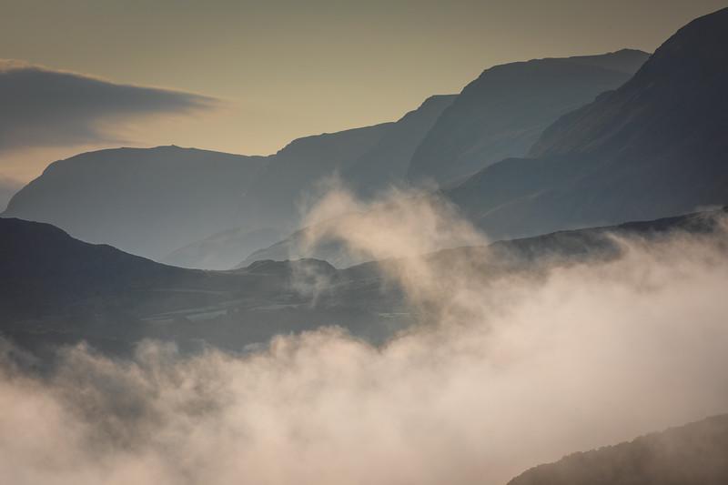 Morning mist rising up towards Cadair Idris