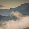 Morning mist rising up towards Cadair Idris