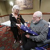 Bobbie Ferrell, with senator Tom Udall's office, presents a flag that flew over the US Capitol to Michael P. E. Hoyt, 86, on Thursday, August 25, 2016. Hoyt is a former State Department employees who was captured and held hostage with his staff in 1964 by Congolese Simba rebels. Luis Sánchez Saturno/The New Mexican