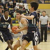 La Cueva's Lawrence Calais, number 12, covers Santa Fe's David Marquez, number 22, during the first quarter of the La Cueva High School vs Santa Fe High School basketball game at Santa Fe on Friday, January 20, 2017. Luis Sánchez Saturno/The New Mexican