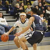 La Cueva's Amarante Rhodes, number 4, covers Santa Fe's Oscar Perez, number 24, during the first quarter of the La Cueva High School vs Santa Fe High School basketball game at Santa Fe on Friday, January 20, 2017. Luis Sánchez Saturno/The New Mexican