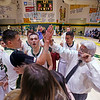 West Las Vegas' DJ Bustos, number 12, high fives assistant coach Steve Sandoval after sinking his 2592nd basket against Taos High School at West Las Vegas on Saturday, February 11, 2017. Bustos now holds the state record for most points scored in a high school basketball career. Luis Sánchez Saturno/The New Mexican