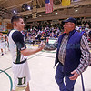 West Las Vegas' DJ Bustos, number 12, shakes hands with Alfred Moreno, who held the record for most point in a career for 40 years, after sinking his 2592nd basket against Taos High School at West Las Vegas on Saturday, February 11, 2017. Bustos now holds the state record for most points scored in a high school basketball career. Luis Sánchez Saturno/The New Mexican