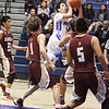St. Mike's Raymond Sena, number 22, goes for a jump shot during the first quarter of the Santa Fe Indian School vs St. Michael's High School during the Horsemen Shootout at St. Mike's on Saturday, January 14, 2017. Luis Sánchez Saturno/The New Mexican