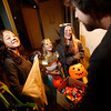 Chris Melomo, right, gives out candy to Noelani Van Loon, 11, far left, a Sea Goddess, Uma Chang, 11, a werewolf, Gredel Holladay, 9, as Cleopatra, and Lilia Holladay, 12, a kitty, while the girls trick or treated on San Felipe Circle for Halloween in Santa Fe on Monday, October 31, 2016. Luis Sanchez Saturno/The New Mexican
