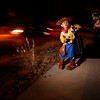 Julian Kilkenny, 3, as Sheriff Woody, lead his mom, Leanna Rael, and his brother Jaxson Kilkenny, as Buz Lightyear, 10 month, while trick or treating on Camino Rojo in Santa Fe on Monday, October 31, 2016. Luis Sanchez Saturno/The New Mexican