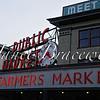 eattle's Pike Place farmers' market building neon sign – a color image