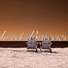 A false-color infrared image of Adirondack chairs perched above the Chesapeake Bay on Virginia's Eastern Shore