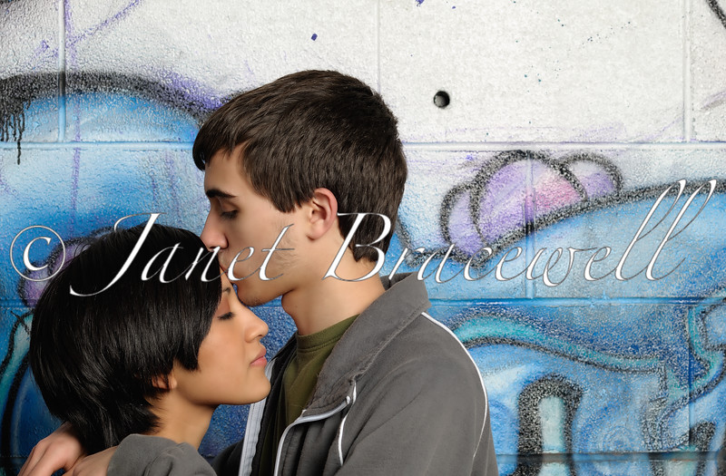Young adult couple kissing - a color image