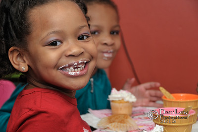 Young African American girl having fun with cupcake - a color image