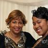 African American mother and daughter pose for portrait - a color image