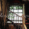 View of stairwell and window of abandoned Forest Haven Asylum - a color image