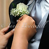 A color image of a boutonniere pinning ceremony