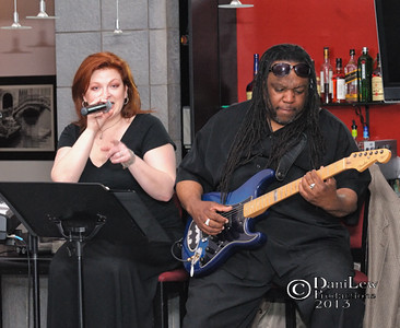 Keli Vale and Richard Tucker performing jazz for audience - a color image