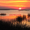 Orange and red sunrise at Oyster on Virginia's Eastern Shore - a color image