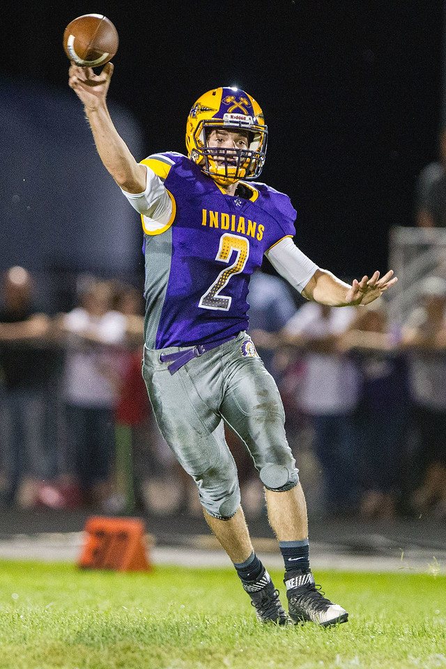 Hononegah quarterback Dominic Ballano (2) rolls out and throws a pass down field during the Indian's season opener against Freeport in Rockton on Aug. 26.