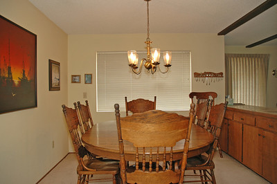 Large dining room features built-in storage to the right.