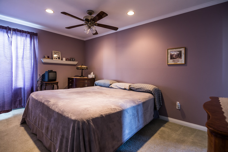 Master Bedroom with ceiling fan and recessed lights