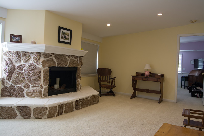 Family room with fireplace and recessed lighting