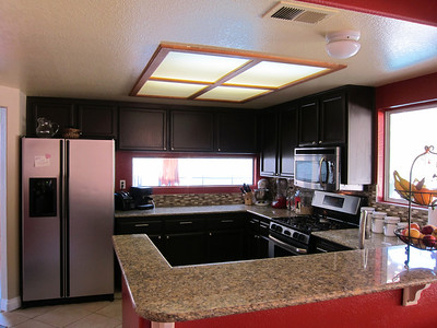 Efficent U-shaped kitchen with tile floors...