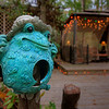Blue Frog on a Post<br /> I'm not a big frog fan, real or otherwise, except for maybe Kermit. My friends have this little guy (or girl?) on a post in their backyard. Their backyard is full of little surprises like this with ornaments in trees, a stone alligator in the grass and other yard art to stir the imagination.