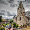 Little French Church<br /> You can't help but notice all the churches as you travel through the French countryside. Every village or town has one. You can see a few others here. This was taken between the rain bursts we drove through while leaving Normandy. The skies had been dark all afternoon and the rain came and went until we hit Paris, when the bottom fell out. Even on a rainy day, it still has an old world charm.