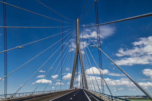 Le Pont de Normandie<br /> Just outside Honfleur, France is the incredible Normandy Bridge. You don't expect this type of contemporary design in the middle of the French countryside.