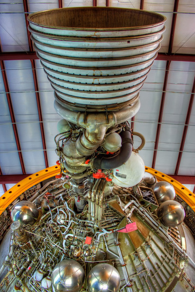"Rocket Science<br /> The Saturn V rocket was the most powerful rocket ever built. The first stage had 5 F1 engines. The second stage had 5 J2, while this third stage has one J2. It required only one, because by this time, it was well away from the strong pull of the earth gravity, plus it had far less weight to push, since it had lost two previous stages and all of the fuel they first contained. <br /> <br /> The phrase ""rocket science"" has multiple meanings; the science it takes to plan and navigate the path into space, the physics of gravity vs. lift, and the mechanics of creating and building something so complex as to push out the amount of thrust these engines created. <br /> <br /> And to think this was state of the art for the 1960s. I can't even fathom the complexity of what it takes to build a station in space or create a reusable vehicle like the Space Shuttle. I guess that's why I just take the photos and leave the science to the real heroes, those scientists that create it."