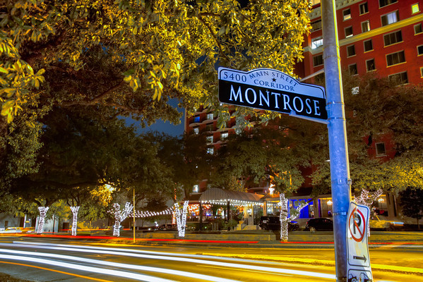 """Montrose<br /> DECEMBER 29, 2012 LEAVE A COMMENT (EDIT)<br /> Montrose is one of those up-town streets in Houston that means different things to different people. When I grew up and through college, it was known as the """"place"""" where people of alternate lifestyles lived. While that is still true to a lesser extent today, it is now considered more of a cultural center that showcases museums, musicians, the University of St. Thomas, fine restaurants and much more. While it may still have a strong night life, many examples of Houston's historic residential architecture in the tree-lined streets with many century-old bungalows and mansions can be found.<br /> This scene with the streaks of passing cars was by the Hotel Zaza close across from the Mecom Fountain."""