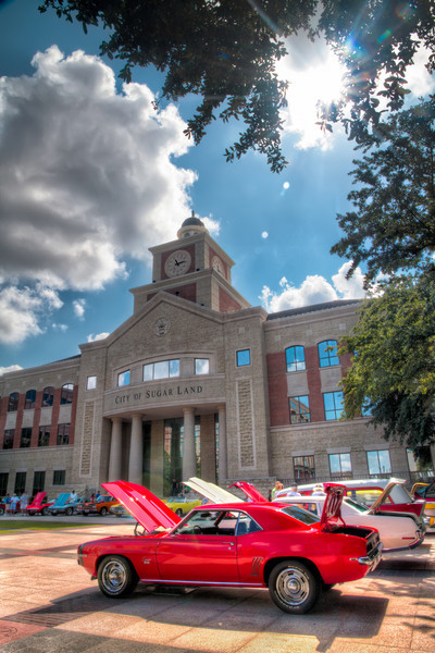 Camero in the Courtyard<br /> Most smaller car shows take place in a local strip center or department store parking lot. This small show was held at the Sugar Land Town Square. Though not large, the quality exceeded the quantity. The City Hall building always makes for a nice background for any activity or event that takes place there.