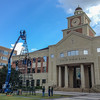 Setting Up the Tree<br /> On this day, I was having lunch by the Sugar Land Town Square and lucked up on the workers assembling the tree. Once again, having the iPhone in hand, the moment was captured.
