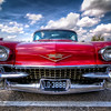 This Eldorado is All Business<br /> Cars, like people, have personalities. Some are meek and mild, while others command respect and authority without having to say a word. This 1958 Eldorado Cadillac has the size, beauty and boldness that you don't argue with. Cars back then meant business and this one takes it very seriously. <br /> <br /> This was one of several Cadillacs that attended Saturday's Wings and Wheels event at the 1940 Air Terminal Museum in Houston, Texas. It was supposed to rain all day, but it turned out to be a great day to take in a few cars and airplanes.