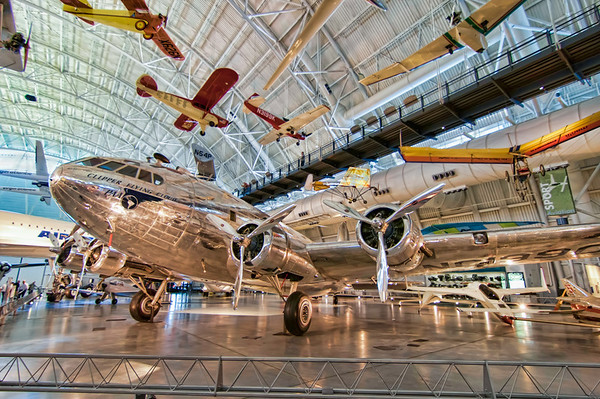 "The Clipper Flying Cloud<br /> The Boeing 307 Stratoliner or ""Clipper Flying Cloud"" was the first airliner with a pressurized fuselage. This beautiful plane is found at the Boeing Aviation Hanger at the Udvar-Hazy Center, part of the National Air and Space Museum."