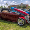 No Brand Required<br /> You don't have to be an auto expert to appreciate a beautiful car. You don't even have to know what year, size engine or even what manufacturer.. You just have to appreciate it for the hard work, time and vision that went into it. As I walk around car shows, I recognize many of the older cars, but occasionally I just like it for what it is and not even recognize if it's a Chevy, Ford or Chrysler. They are always easier to identify if their big logo is on the front, but with custom versions that have been de-badged, it can be hard to tell. So, I'll just say that this is a pretty, red hotrod. No brand required.