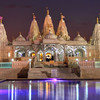 Evening at the Mandir<br /> The more photos I shoot, the more I enjoy nighttime photography. It's a bit more challenging and more work, since you must have a tripod, remember that moving objects might blur and other factors that you don't have to worry about during the day. But in the end, it can be very rewarding and well worth your time.  If you haven't tried it yet, you should!  Then again, it helps if you have a beautiful building with lots of pretty lights.<br /> This is another view of the Hindu Mandir in southwest Houston.