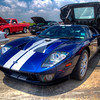 Ford GT<br /> The Ford GT is a mid-engine two-seater sports car. Ford Motor Company produced the Ford GT for the 2005 to 2006 model years. The designers drew inspiration from Ford's GT40 racing cars of the 1960s. This was a car, straight from the factory, that had the class and performance to rival anything you could purchase in overseas. Of all the cars I've seen, this model is one of my most favorites.