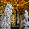 The Lion Guards of Versailles<br /> Versailles has to be seen to believe. Extravagant is too weak of an adjective to describe it. Every room has something more than what you expect in the way of paintings, architecture and furnishings. With the addition of modern add sprinkled about, you never know what to expect. Gardes are two warlike lions in white lace napkins by Franco-Portuguese artist Joana Vasconcelos, the first woman to exhibit in the garden rooms of Versailles. Much of the modern art there seems out of place at times. Although these lions are covered in white lace, at least they are still lions.