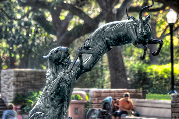 The Hunt<br /> The Circle of Life. You are born. You live. You are eaten.<br /> Okay, maybe if you're an impalla being chased by a lion or other hungry carnivore that has to hunt for its dinner. Just such a scene is played out in this statue.<br /> The Houston Zoo has a tree lined fountain where you can rest your tired feet and watch the two-legged animals with baby strollers walk by. Their statue in the water feature reminds you of the reality of animal kingdom and that the circle does have an end.